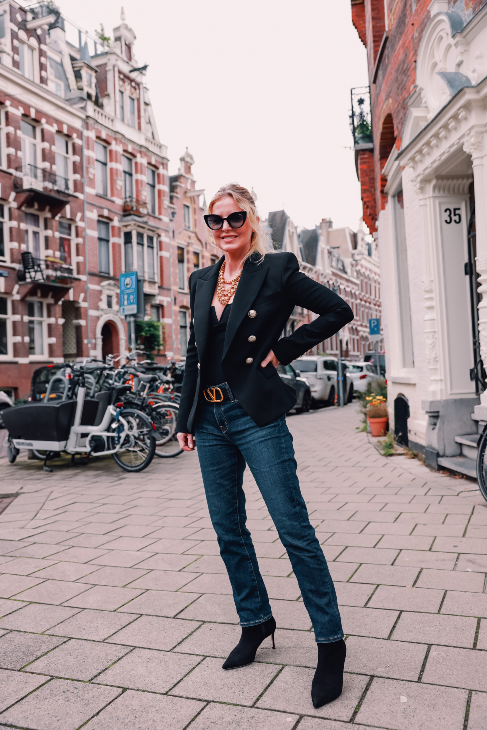 relaxed fit jeans by AG on fashion blogger over 40 Erin Busbee of Busbee STyle in Amsterdam Holland
