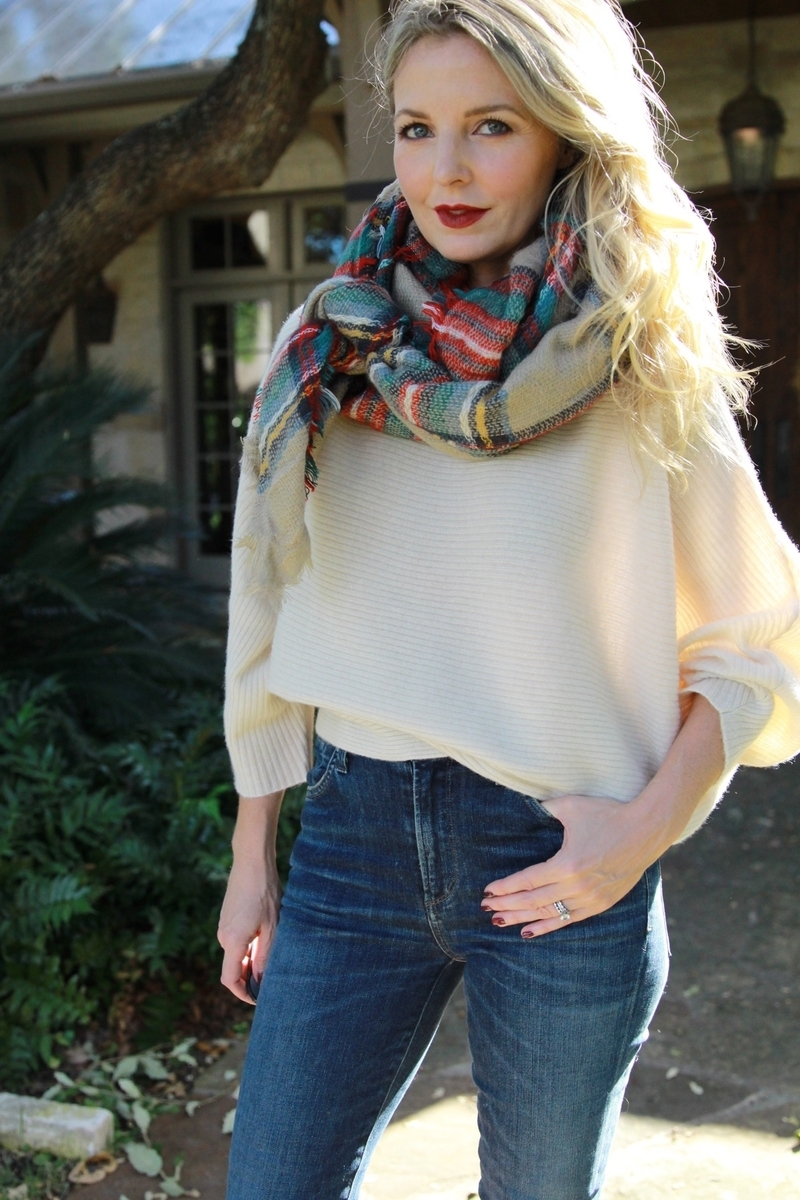 knotted red and green blanket scarf with white cashmere sweater by marled by reunited from neiman marcus last call and high low, carlie skinny jeans