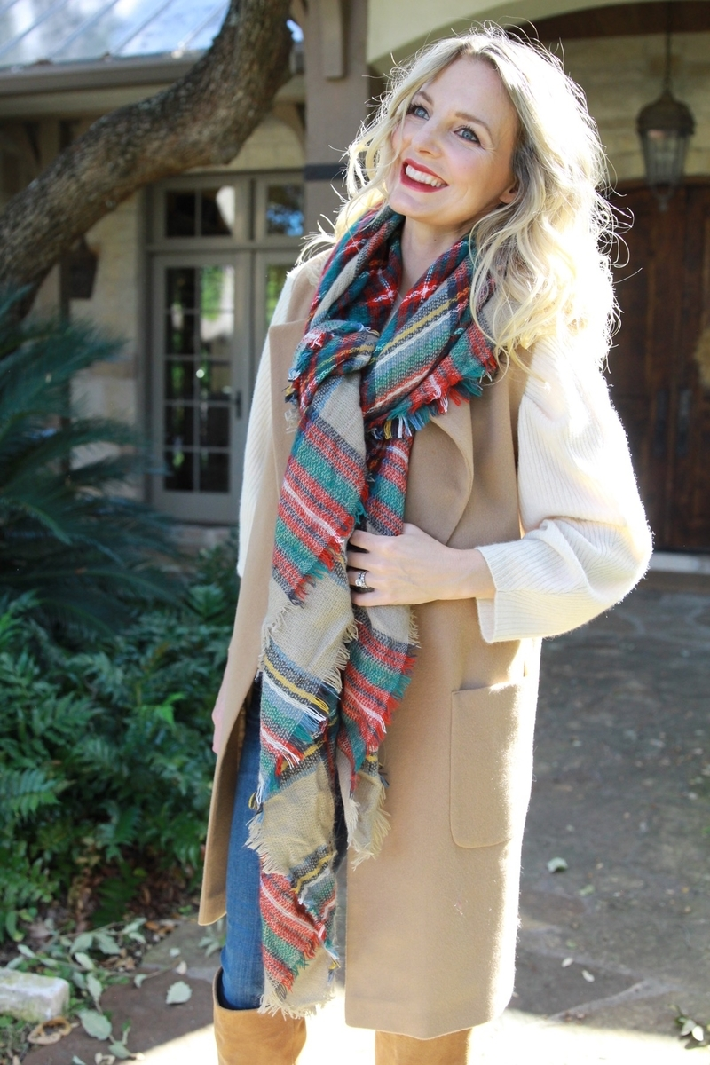 red and green plaid blanket scarf loosely tied with a longline camel vest from nordstrom