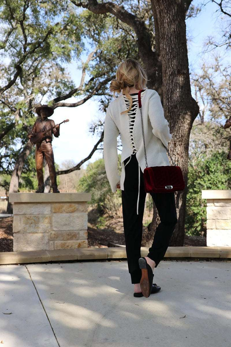 This laceup detailing on the back of the ivory ALC sweater gives it some interest and definitely a sporty touch. It's a subtle way to try the athleisure trend. This look is from neiman marcus