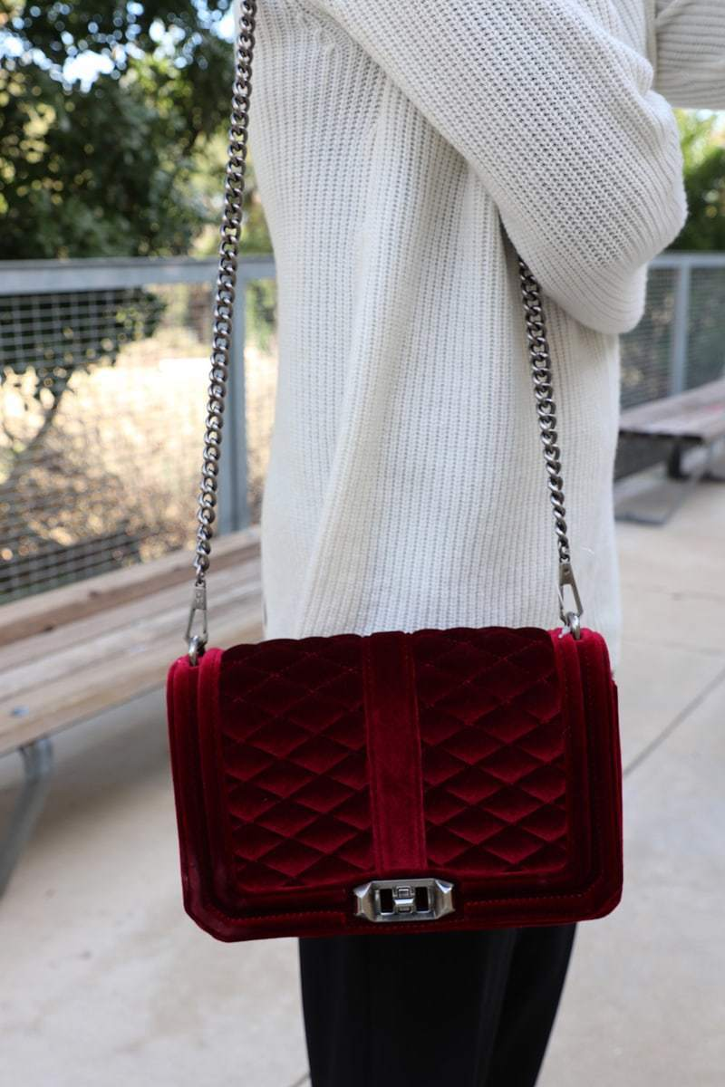this ALC white sweater with a laceup back is sporty and incredibly chic and comfortable. The oversized slouchy sweater looks great paired with jogging pants by norma kamali. The velvet love crossbody bag by rebecca minkoff adds a dash of sophistication and pop of color