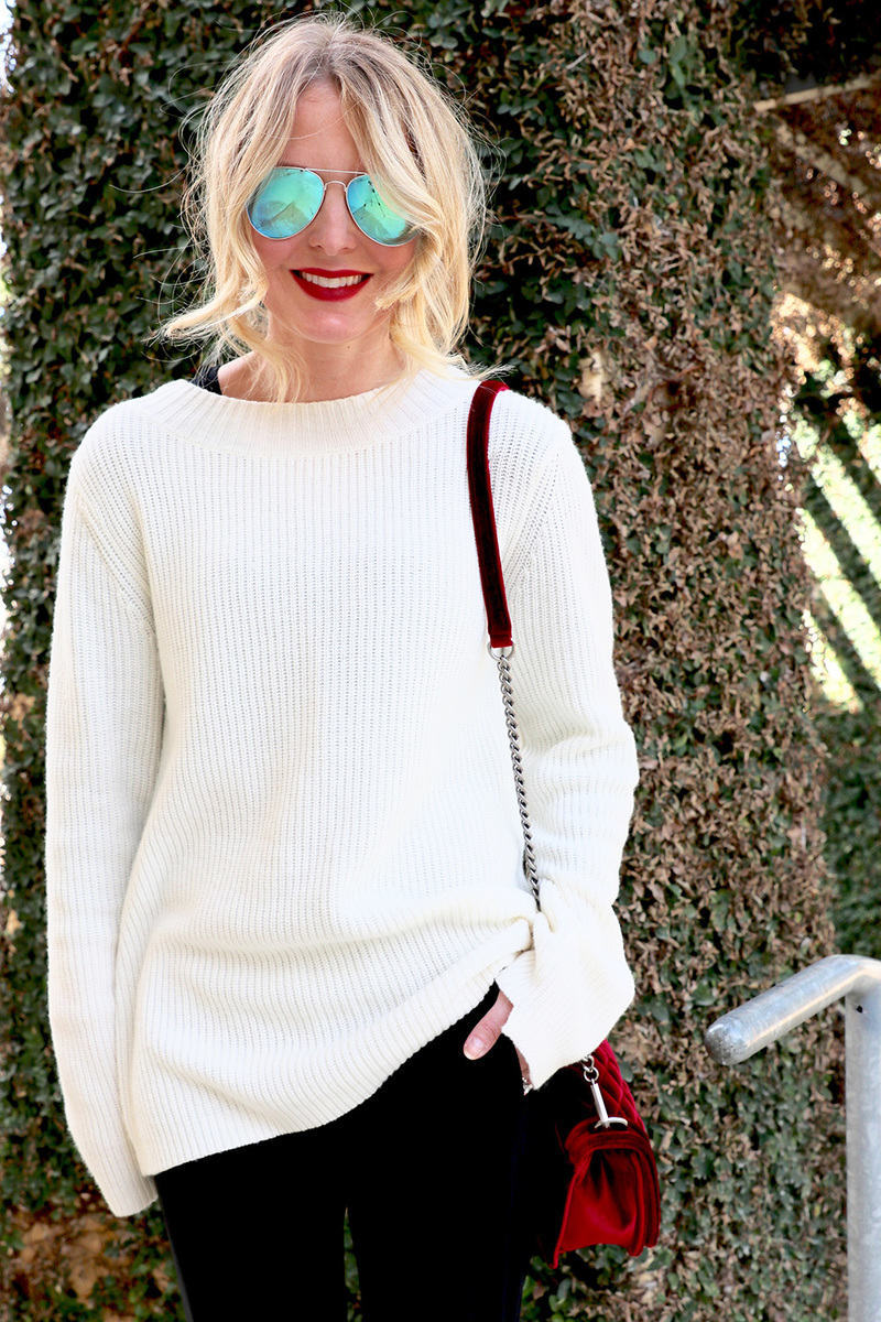 the velvet bag by rebecca minkoff adds a dressy and elegant element to an otherwise pretty casual and sporty outfit. This is one way to try the athleisure trend. The laceup detailing on the ALC sweater is another sporty touch