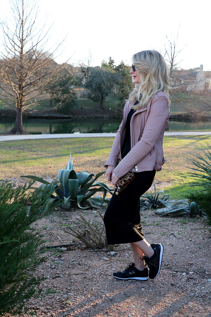 erin busbee of busbeestyle.com showing you one way to try the athleisure trend: add some chic sneaks to your jersey dress and layer a moto jacket over the dress