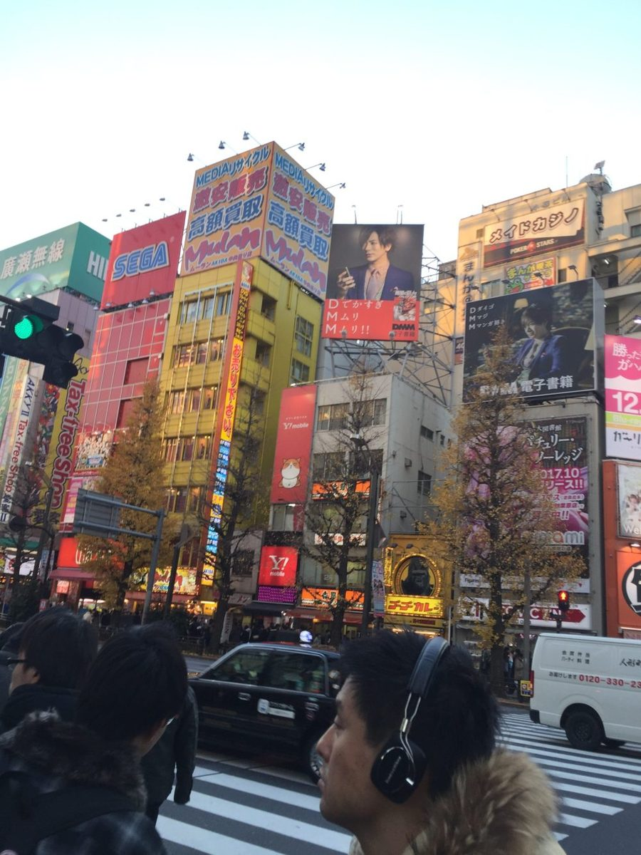 walking through the streets of tokyo japan on a family vacation looking at all the city lights and modern buildings