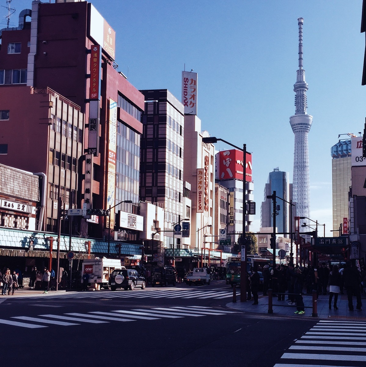 city streets in tokyo with a view of the stunning sky tower