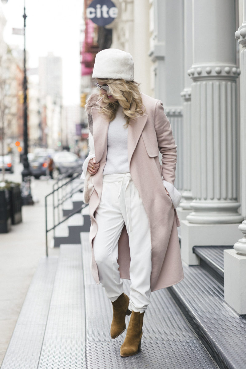 Erin Busbee at New York Fashion Week 2017 in soho en route to meetings wearing winter white and a pink topper coat by Selected Femme from Asos