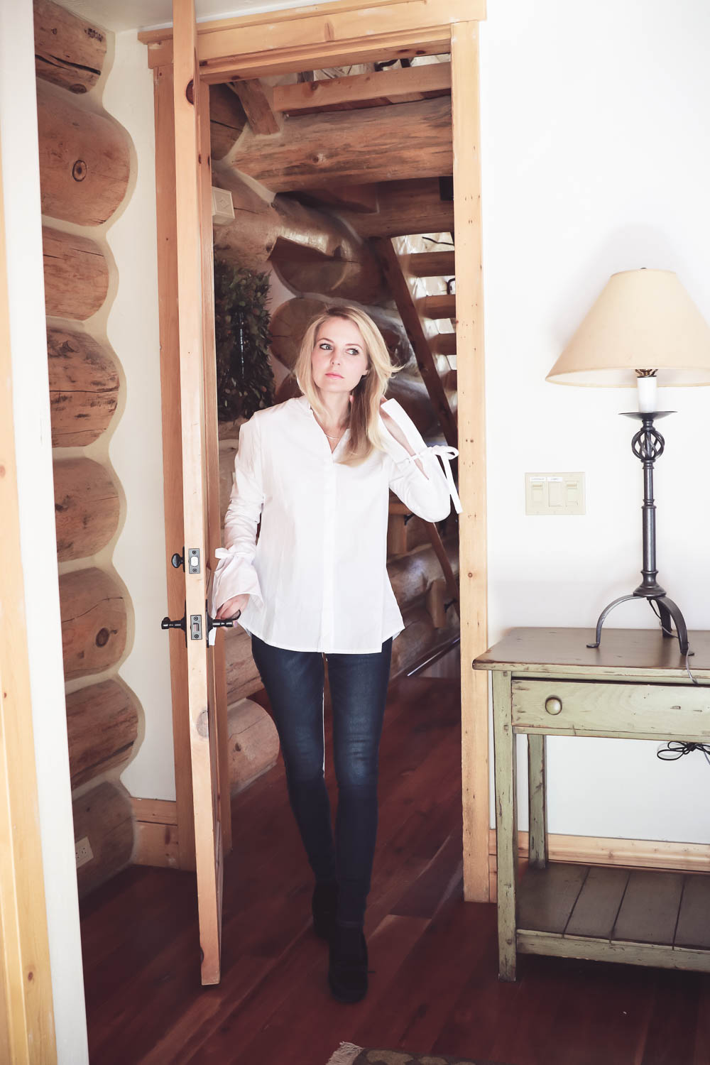 Laceup top by MLM in white button down poplin worn by Erin Busbee, fashion blogger and youtuber based in San Antonio, Texas. The laceup detail is a big fashion trend right now. Look for laceup pumps, flats, jeans, pants, tops, sweaters and jackets!