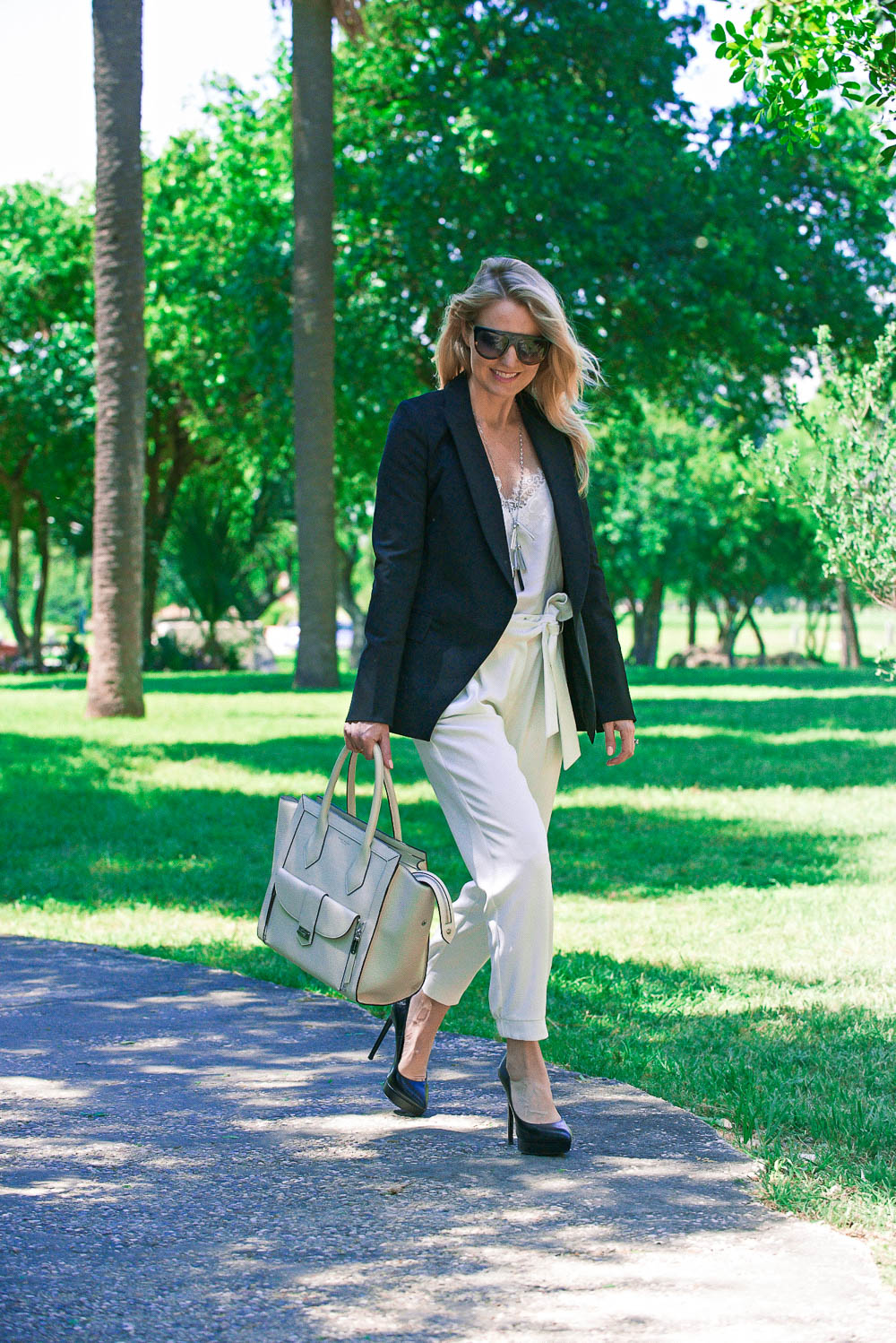 White bags are white hot for spring/summer! These trendy bags are neutral and versatile and will go with everything in your wardrobe. This post features white bags from Henri Bendel including the Rivington tote, a wallet and a mini crossbody white bag picked by fashion blogger and youtuber Erin Busbee of Busbee Style