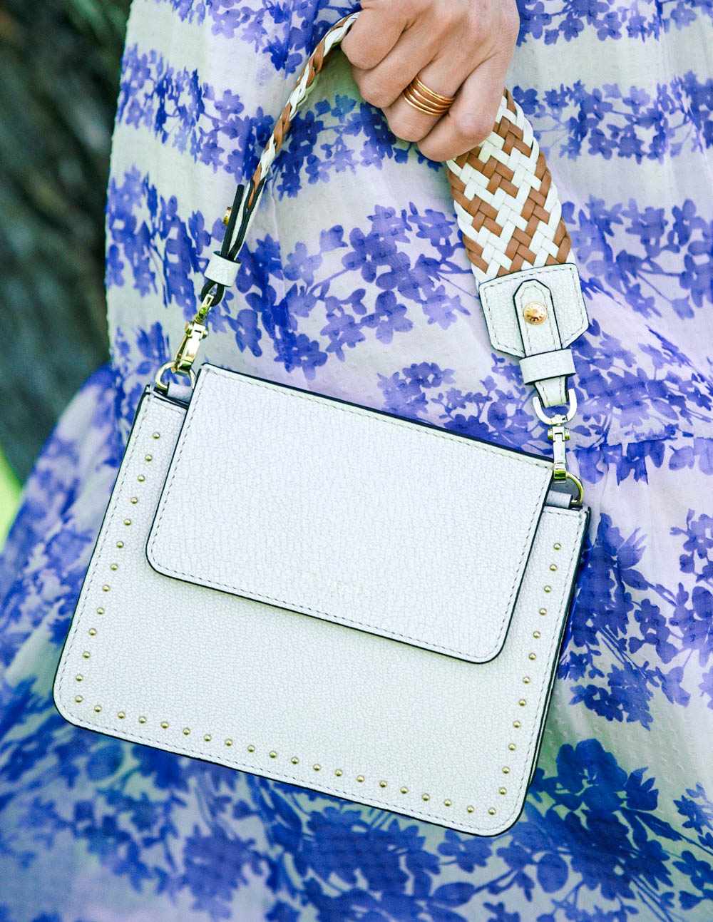 White bag from Henri Bendel. This tini, woven handle, crossbody bag with small gold studs from Henri Bendel is the perfect size for your next special event or wedding. Featured by Erin Busbee, fashion blogger and youtuber for busy women over 40 from Busbee Style