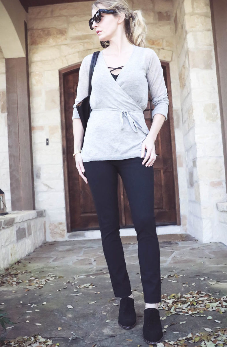 Erin Busbee wearing rag and bone slimone pants in black with a wrap sweater from Nordstrom and carrying sole society black tote vegan leather