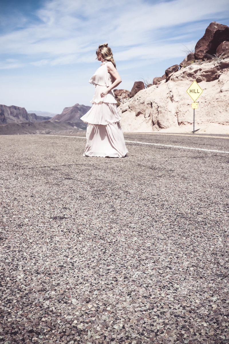 Ruffle gown on the Rio Grande river, fashion blogger and fashion youtuber over 40, Erin Busbee shows us one way to wear a statement dress in nude color
