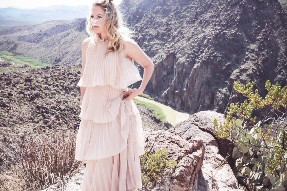 Ruffle gown on the Rio Grande river, fashion blogger and fashion youtuber over 40, Erin Busbee shows us one way to wear a statement dress in nude color, tiered dress, ruffles