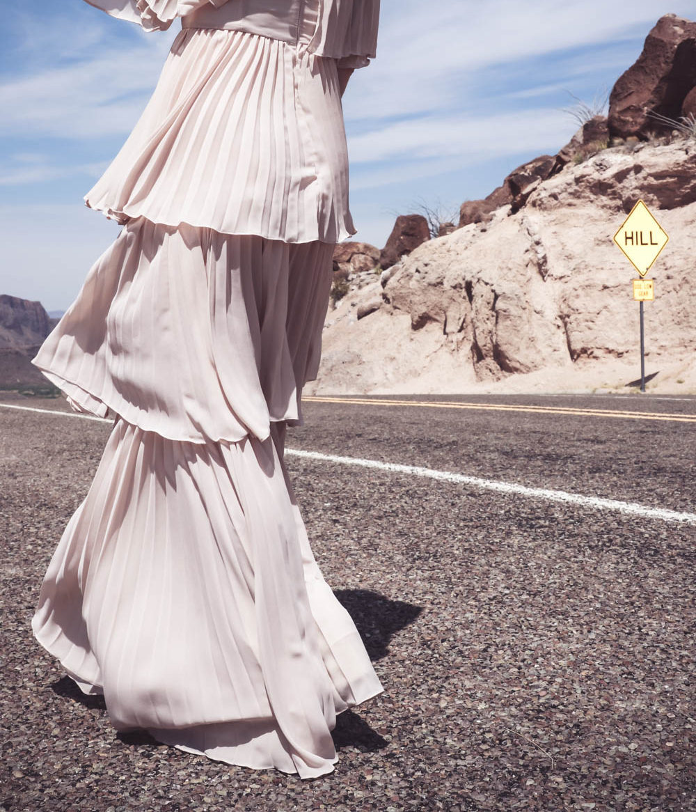 Ruffle gown on the Rio Grande river, fashion blogger and fashion youtuber over 40, Erin Busbee shows us one way to wear a statement dress in nude color // gorgeous women's dress for special occasion, even or party including a wedding or bridesmaid dress