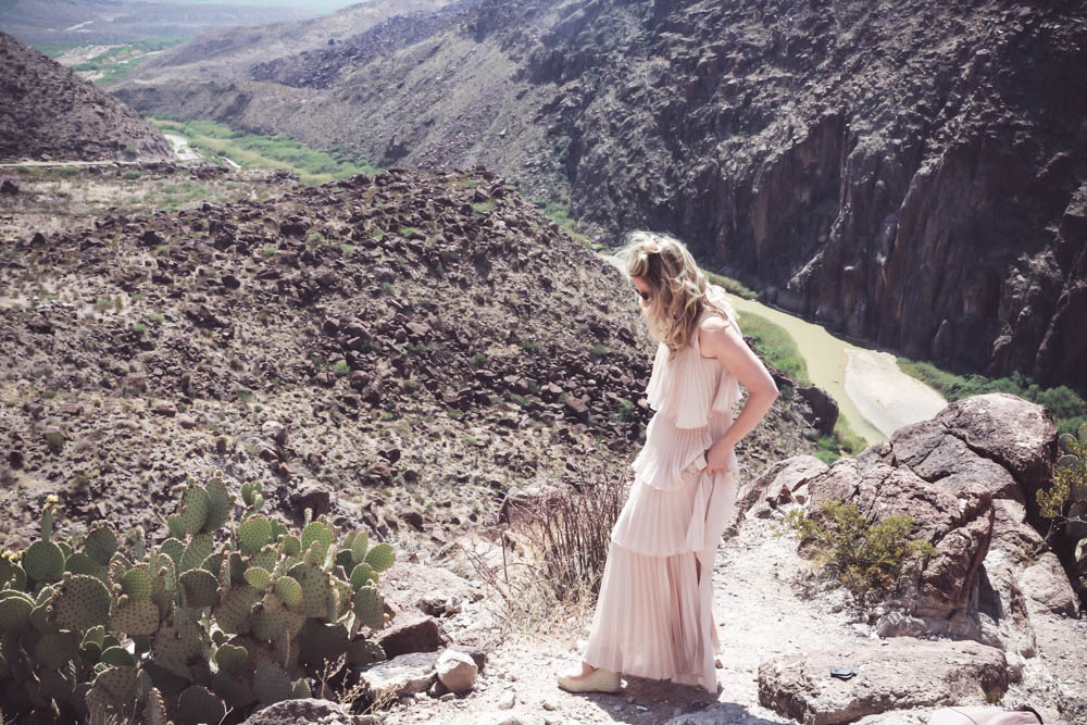 Special occasion statement dress on fashion blogger and fashion youtuber from san antonio, texas, erin busbee, wearing a tiered, pleated gown from Asos