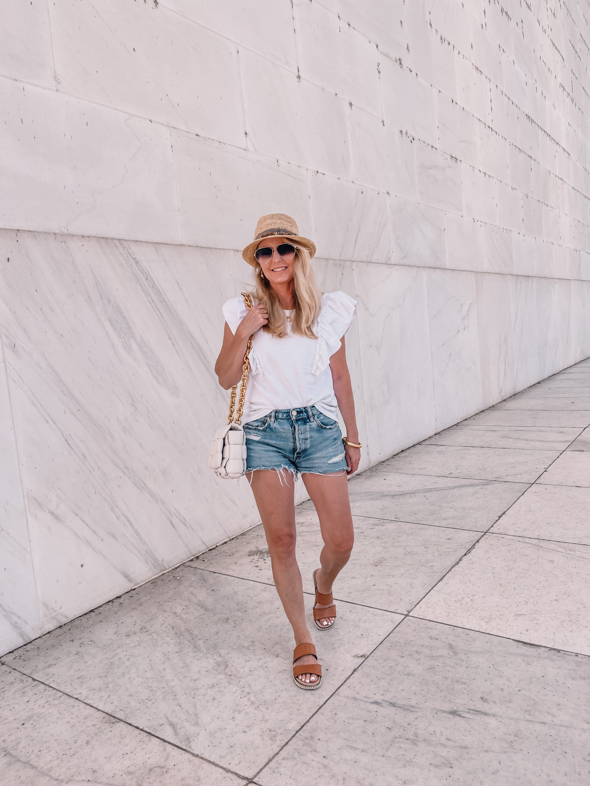 outfits for long road trip featuring Moussy jean shorts and white ruffle shoulder tee by Nation LTD on fashion over 40 blogger Erin Busbee in Washington, DC