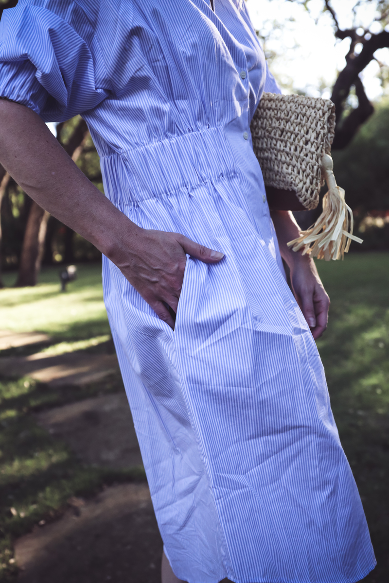 Blue and white striped shirt dress, Ann Taylor straw basket bag with tassel, and Marc Fisher nude wedges on erin busbee, of busbeestyle.com