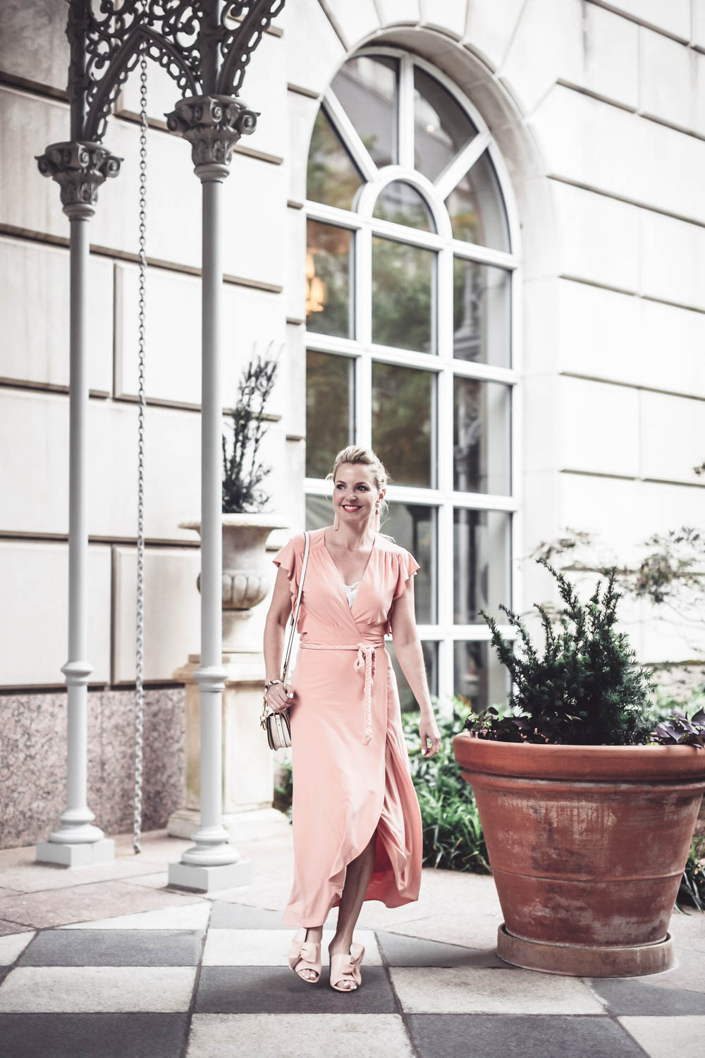 Peach dress by Misa from Revolve Clothing on fashion blogger and youtuber, Erin Busbee, San antonio, Texas, at the Crescent hotel in Dallas for the Reward style conference