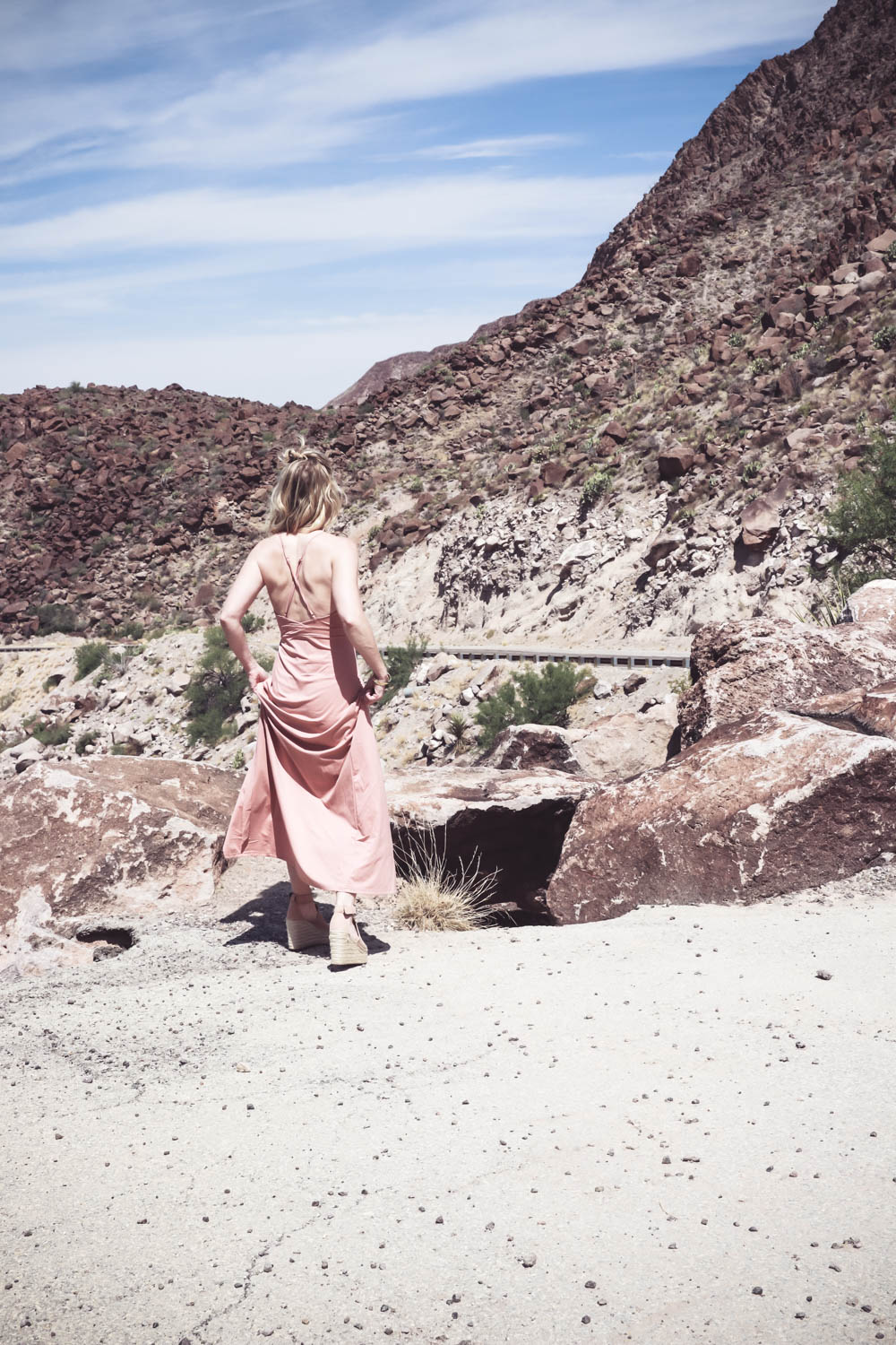 Wrap Dress in blush nude color on fashion blogger and fashion youtuber erin busbee of busbestyle, san antonio, texas, shot near Big Bend National Park in West Texas along the Rio Grande, women's dress ideas