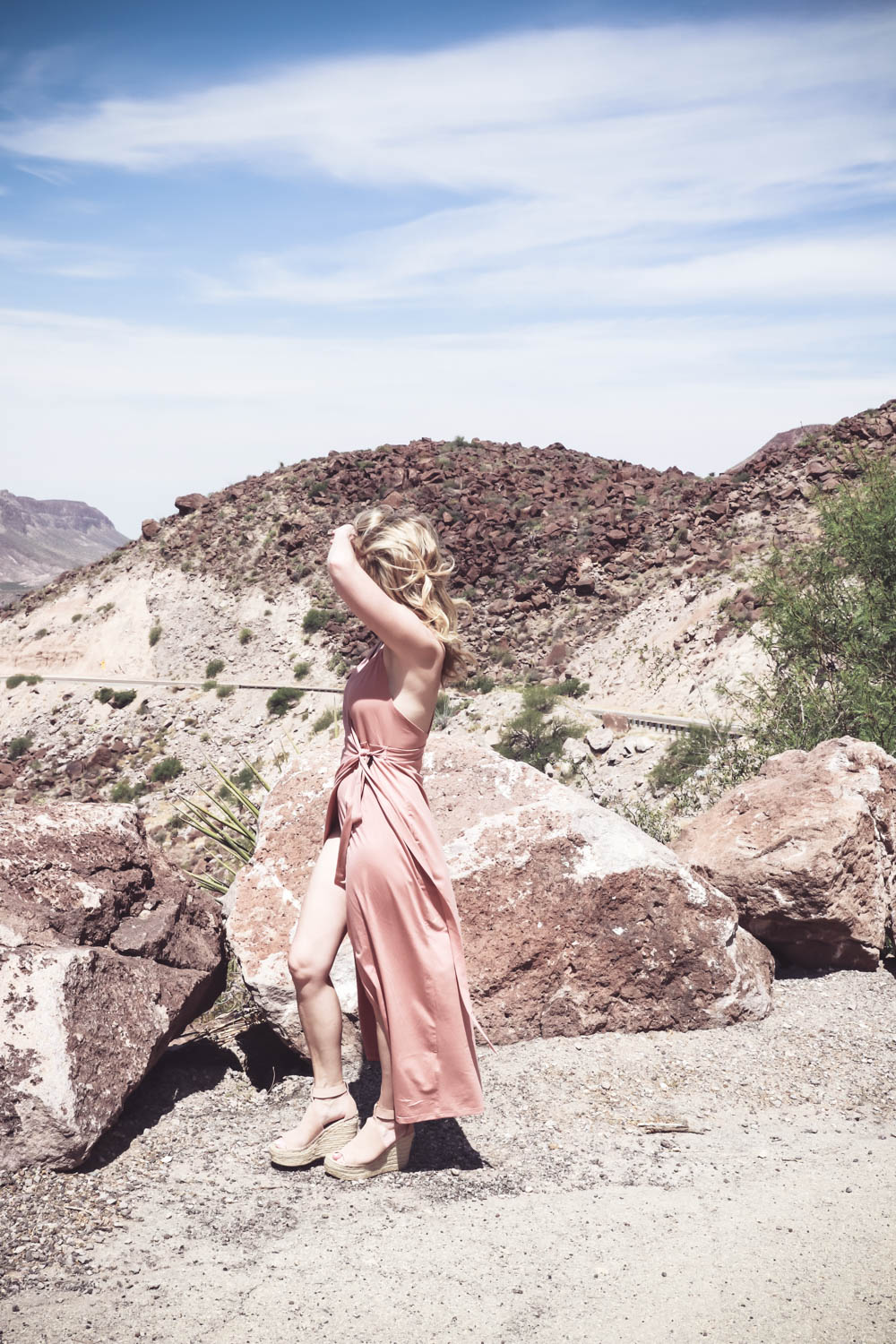 Wrap Dress in blush nude color on fashion blogger and fashion youtuber erin busbee of busbestyle, san antonio, texas, shot near Big Bend National Park in West Texas along the Rio Grande, fashion ideas for women over 40