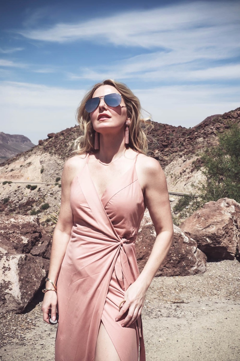 Wrap Dress by Wyldr from Asos and Revolve in blush nude color with Marc Fisher perforated ankle strap espadrilles wedges, on fashion blogger and fashion youtuber erin busbee of busbestyle, san antonio, texas, shot near Big Bend National Park in West Texas along the Rio Grande, with mirrored aviator sunglasses