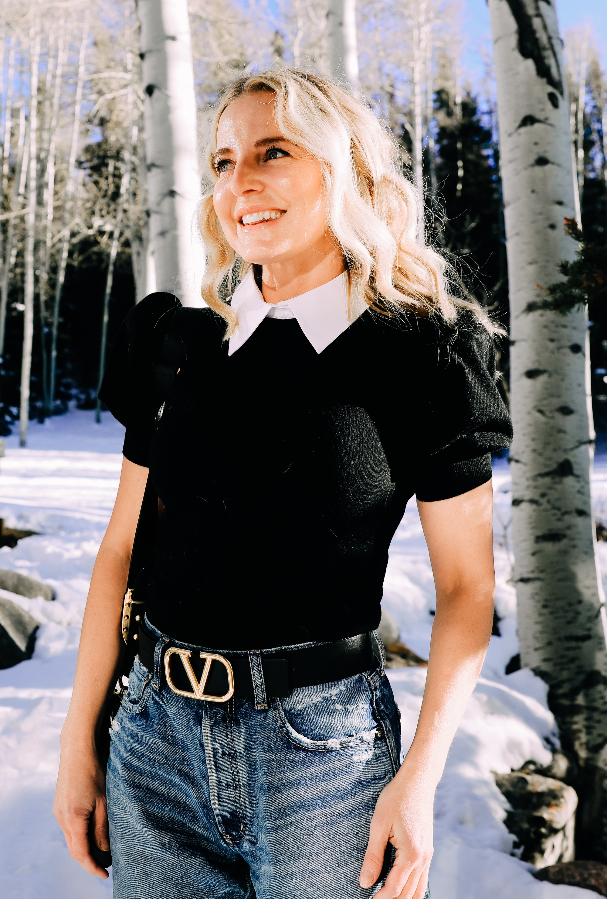 Spring and summer fashion trends, erin busbee of busbee wearing a statement collar sweater by alice + olivia with baggy jeans in telluride colorado
