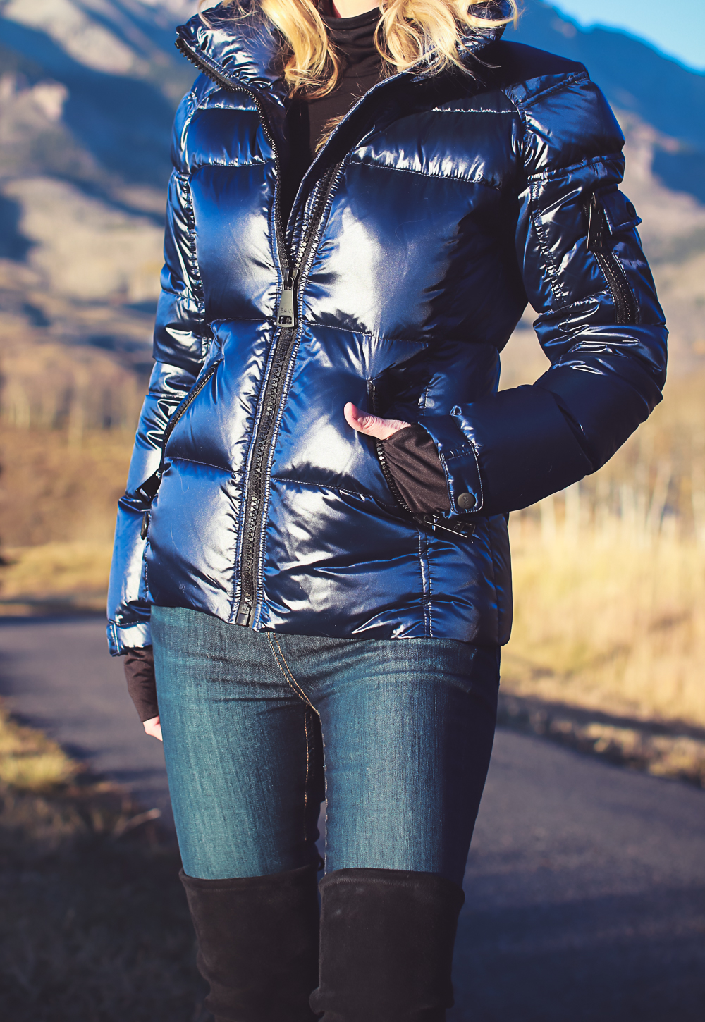 Black turtleneck with SAM. puffer jacket from Bloomingdales and Stuart Weitzman Lowland Boots