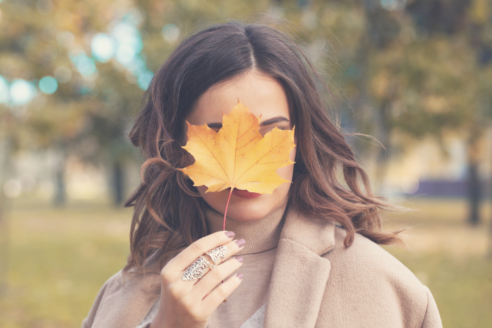 fall makeup, three ways update fall makeup routine, beauty 40+ woman, dark haired women with a leaf covering her face