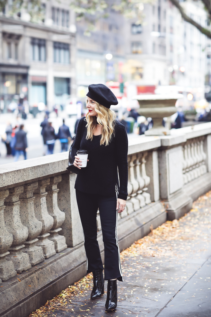 Beret, how to style a beret, how to look french, Erin Busbee of Busbee Style, fashion blogger over 40, walking in NYC with her black beret and all black look including Mother striped jeans, vince camuto patent booties and aqua cashmere choker sweater