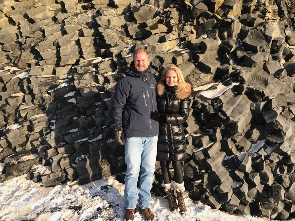 Planning a trip to Iceland | Reynisfjara Beach in Vix, basalt columns Erin Busbee of Busbee Style and her husband Chris, what to wear and what to pack