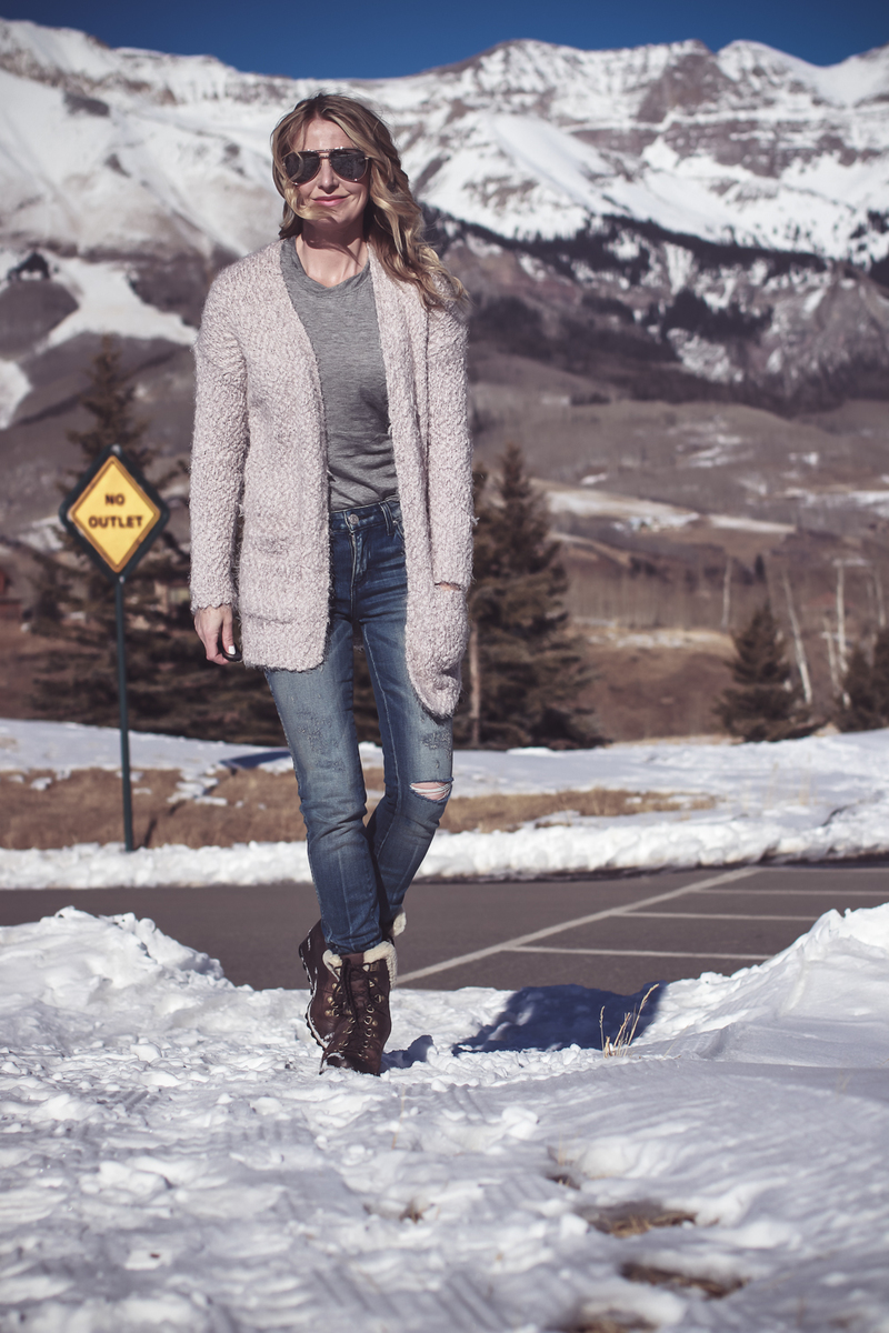 Fuzzy Cardigan sweater paired with Sorel Conquest boots, AMO twist jeans, on fashion blogger over 40, Erin Busbee of Busbee Style in Mountain Village, Telluride Colorado
