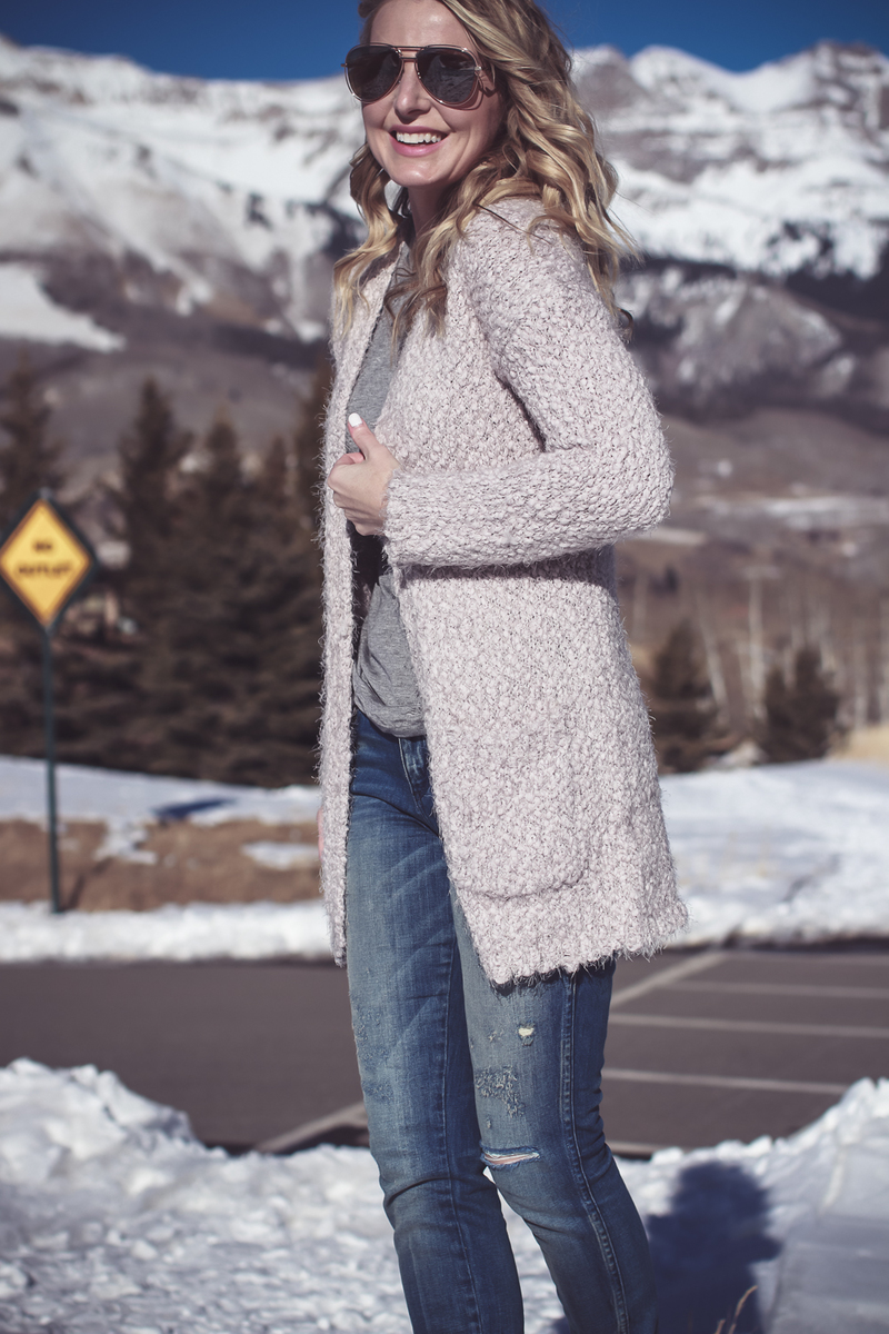 Fuzzy Cardigan sweater in beige from Nordstrom, paired with Sorel Conquest boots, AMO twist jeans, on fashion blogger over 40, Erin Busbee of Busbee Style in Mountain Village, Telluride Colorado