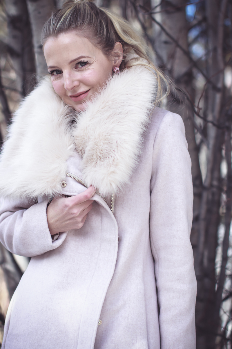 Faux Fur Coat, glam winter coat option in pale pink by Club Monaco on Fashion blogger, Erin Busbee of BusbeeStyle.com and Busbee Style in Telluride, Colorado with over the knee suede, Marc Fisher boots and white jeans
