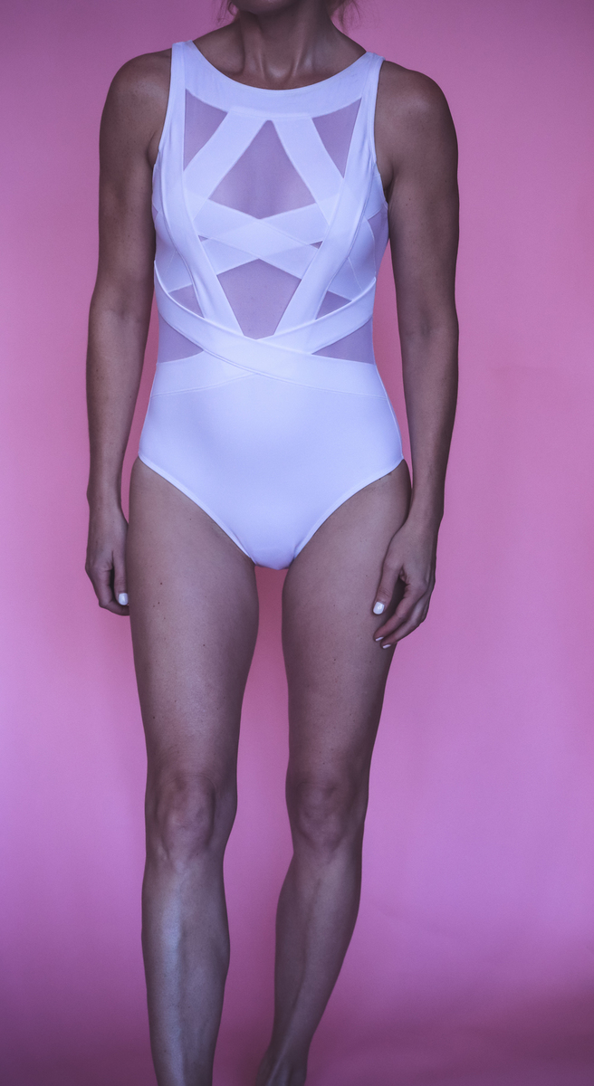 Beach picks, wearing Oye white one piece swimsuit with mesh panels, on fashion blogger Erin Busbee of BusbeeStyle.com