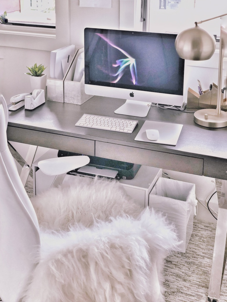 organizational tips by lifestyle blogger Erin Busbee of Busbee Style sharing her office space with sheepskin rug, lamp from Target, magazine bins from West Elm
