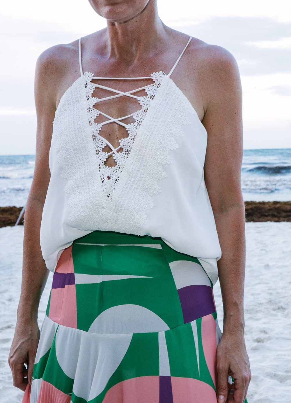 Maxi Skirts, my picks including this gorgeous pleated pink and green maxi skirt by Alexis paired with a WAYF lace up cami in white on the beach in Tulum, Mexico
