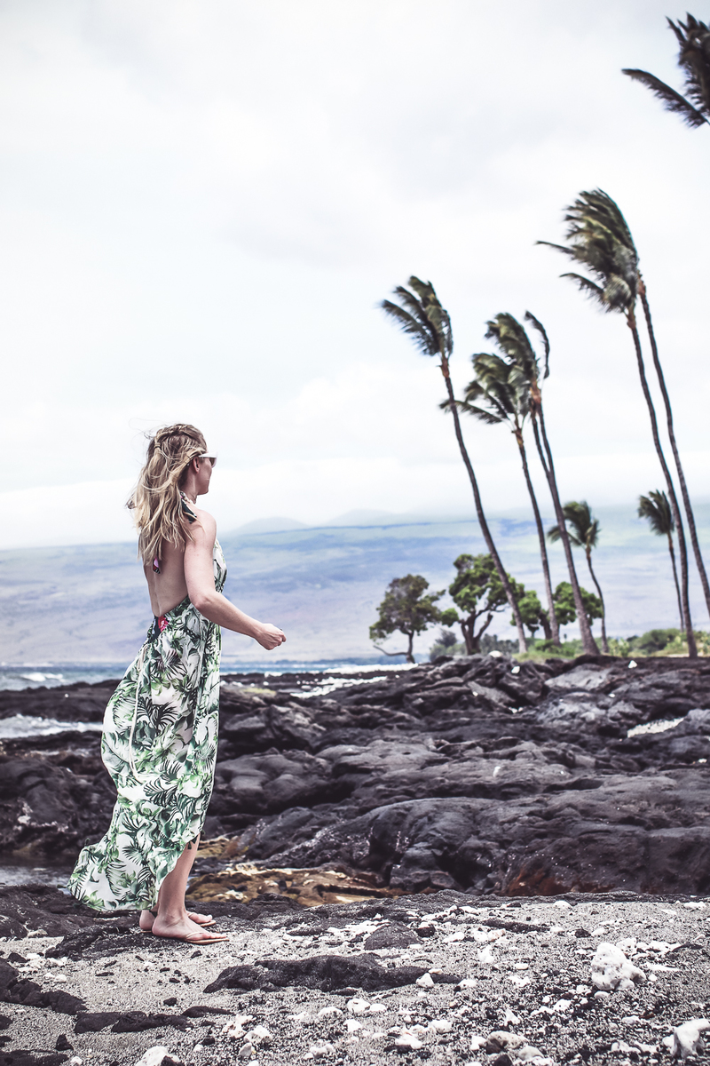 palm print flowy beach coverup from Everything but water on blond woman with retro white sunglasses on blond woman