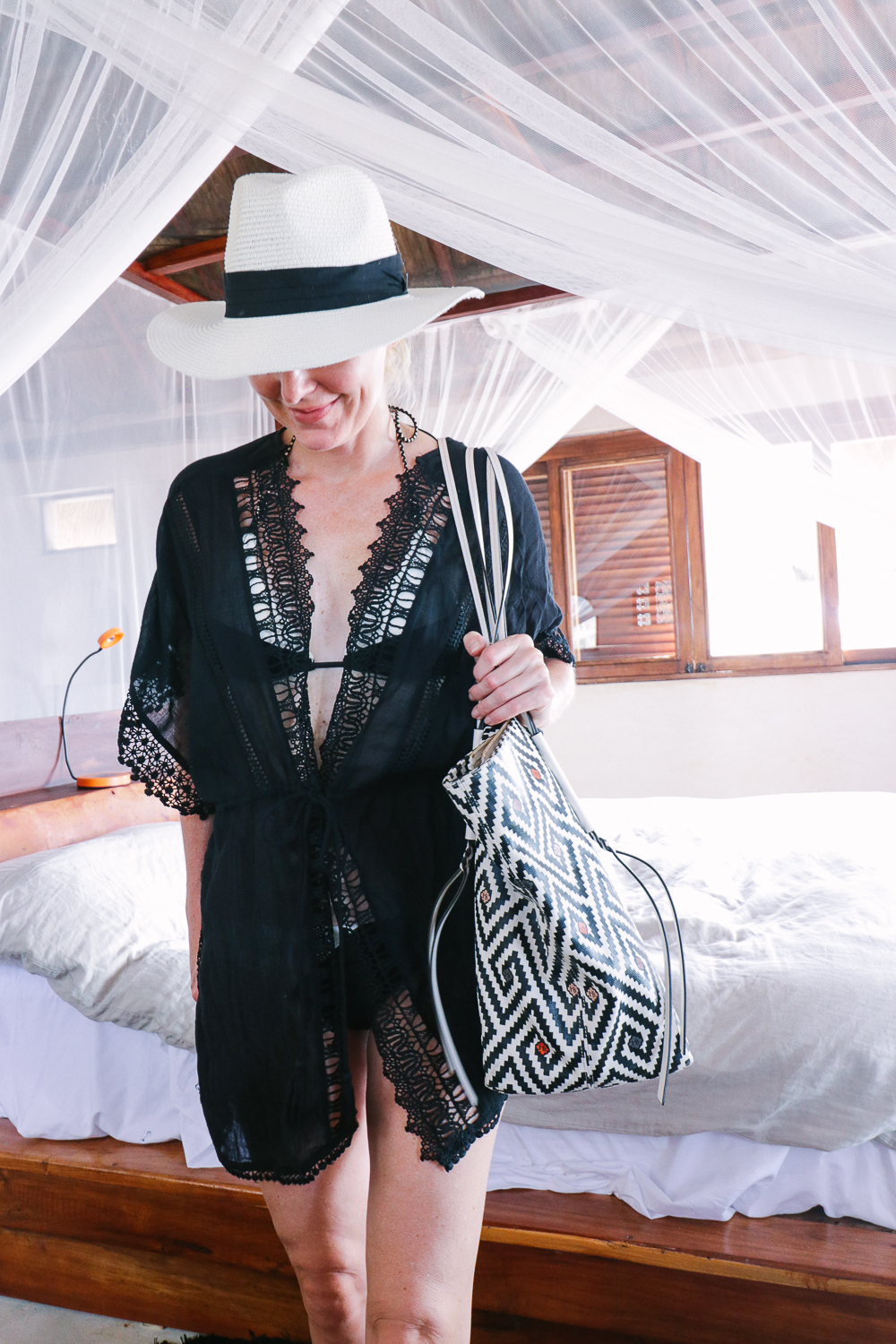 favorite beach or pool swim coverups on blonde woman featuring a Topshop lace kimono coverup and a black and white panama hat with Vix bikini