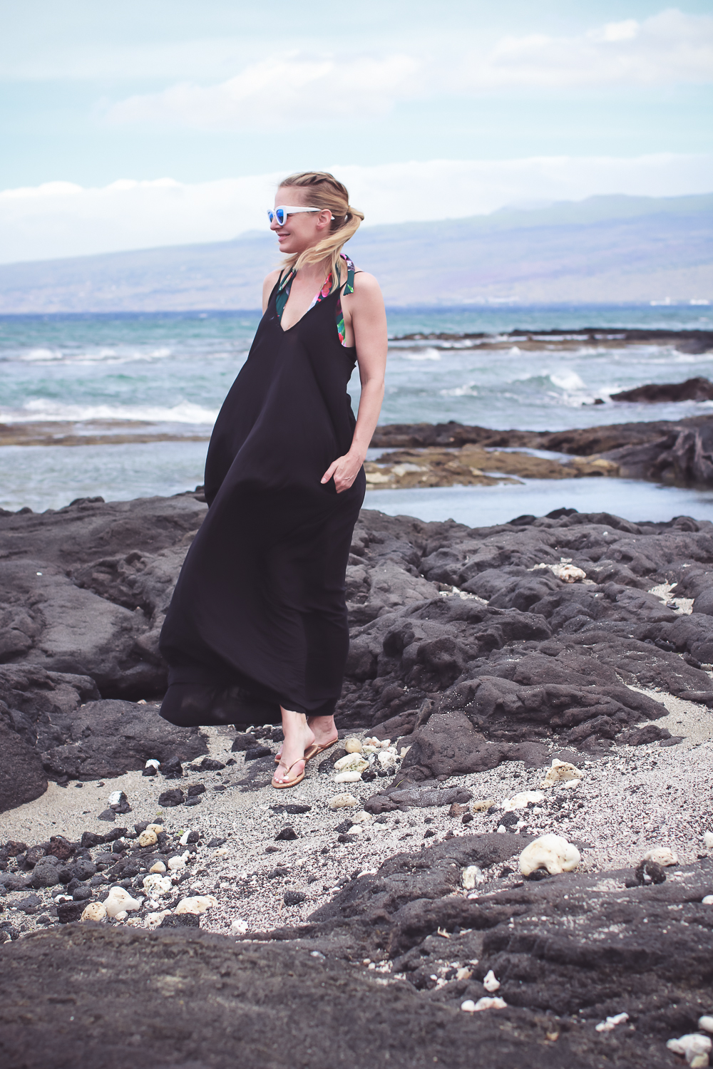 black Elan halter maxi dress swim coverup worn over bathing suit in tide pools on the beach