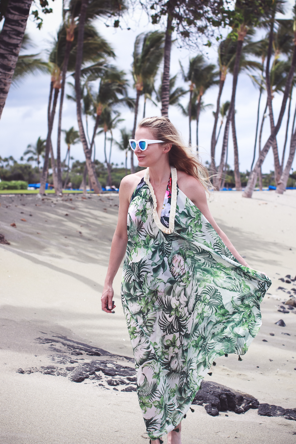 favorite beach or pool swim coverups on blonde woman featuring a palm print flowy coverup and La Blanca tropical jungle one piece swimsuit with white retro sunglasses
