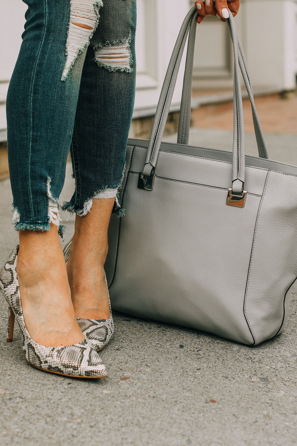 Vince camuto python print pumps paired with distressed skinny jeans by Express