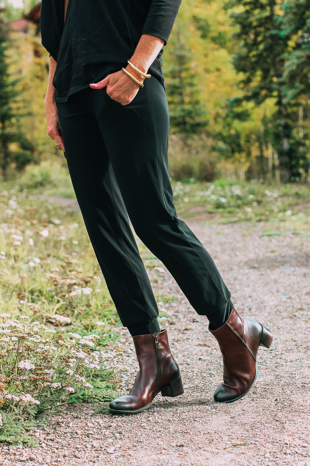 ankle boots for walking in Bison brown with low block heel and comfort, cushion technology by ECCO on fashion blogger in black joggers by Norma Kamali and black off shoulder top with brown crossbody bag, best items from shopbop sale