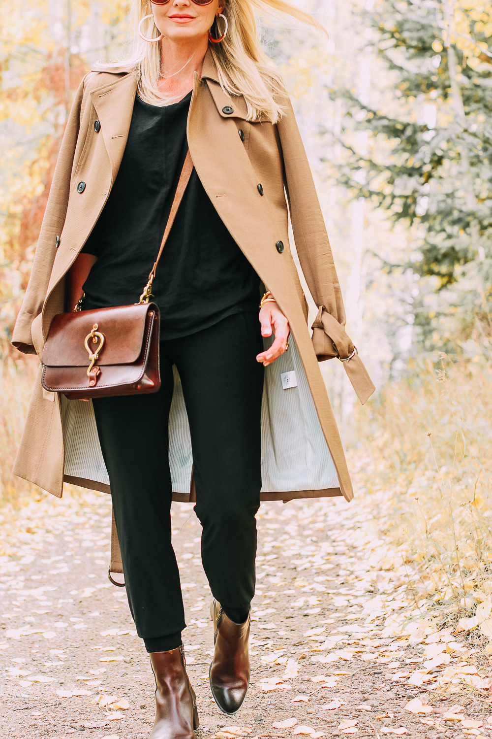 ankle boots for walking in Bison brown with low block heel and comfort, cushion technology by ECCO on fashion blogger in black joggers by Norma Kamali and black off shoulder top with brown crossbody bag