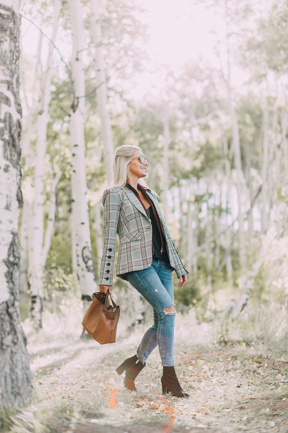 Fall Booties 2018 featuring Vince Camuto black suede side zip booties with a veronica beard plaid blazer and blankNYC jeans on fashion blogger over 40, Erin Busbee of BusbeeStyle.com