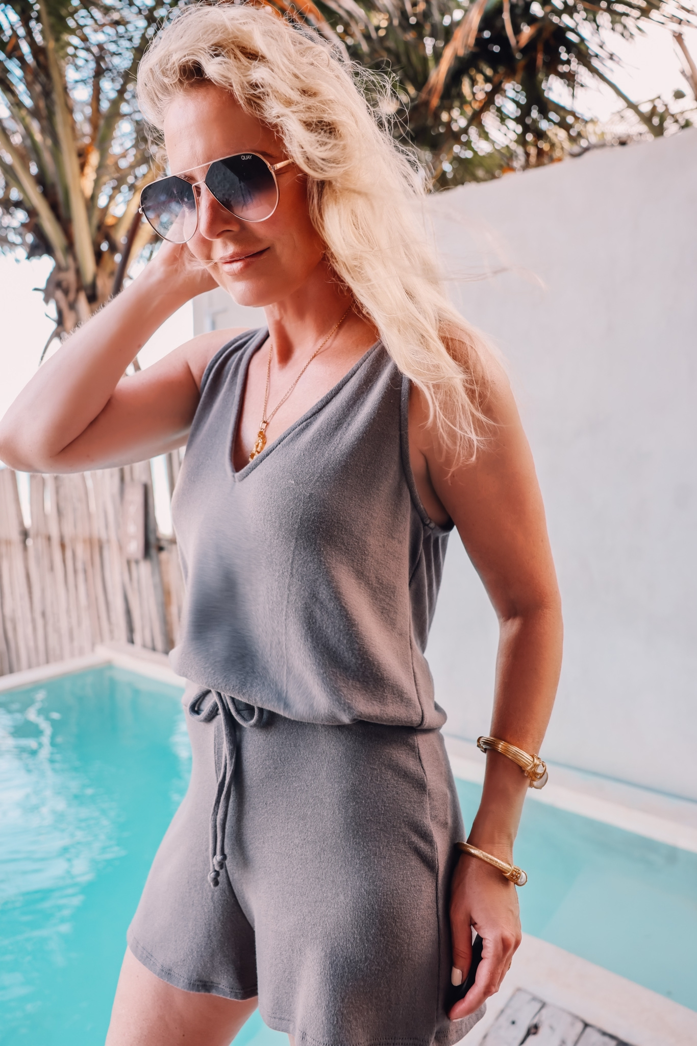 gray lovers + friends romper on fashion over 40 blogger Erin Busbee