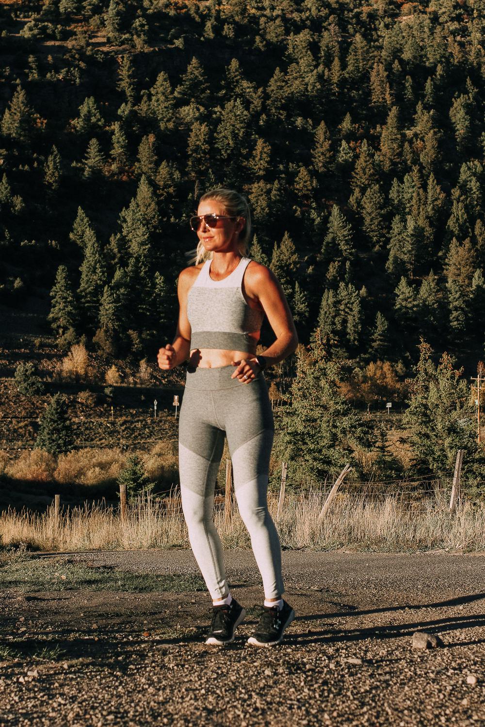 outdoor voices activewear worn by busbee style with Fitbit Versa smartwatch for running