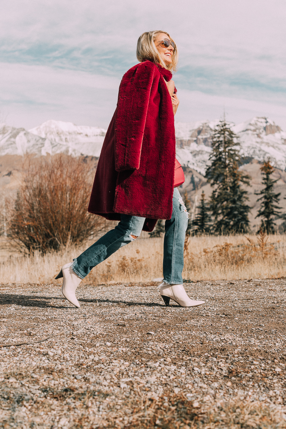 Bootie Trend, how to wear your ankle boots with dresses and jeans featuring white booties with a cone heel by Vince Camuto paired with a reversible faux fur coat, white turtleneck and Mother dazzler jeans