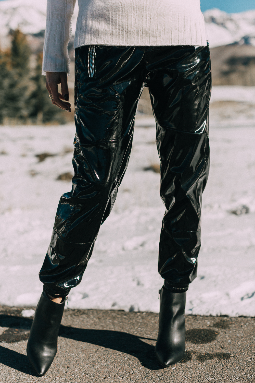 Black vinyl pants by RtA on Fashion blogger over 40 Erin Busbee with black booties by Michael Kors and a white cashmere sweater by Brochu Walker