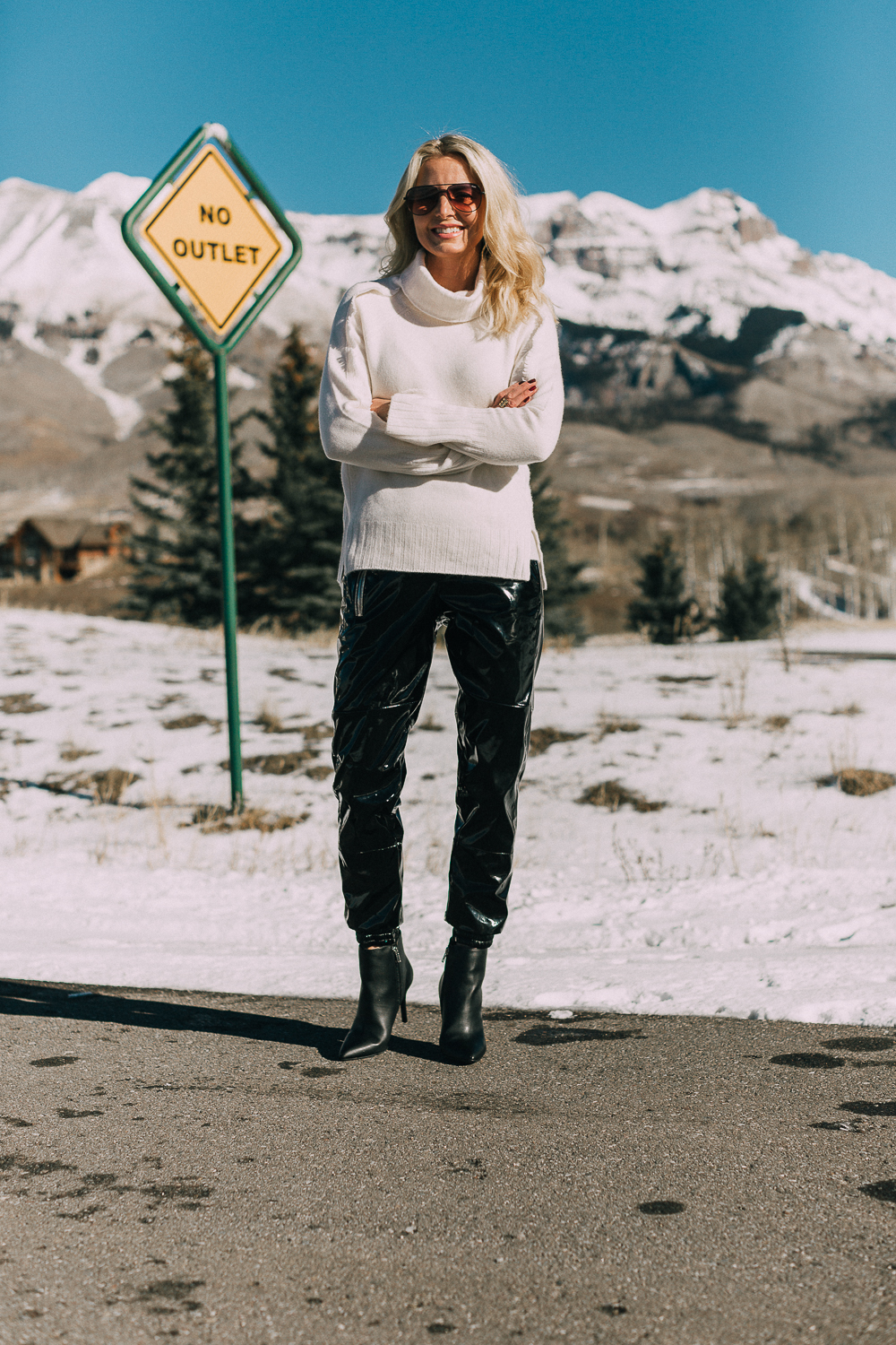 Black vinyl pants by RtA worn with a white turtleneck cashmere sweater by Brochu Walker with black booties by Michael Kors worn by blonde fashion blogger Erin Busbee of Busbee Style