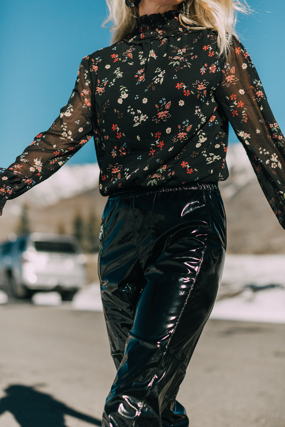 Dark floral blouse by Sanctuary tucked into black vinyl pants by RtA worn by fashion blogger Erin Busbee of BusbeeStyle.com