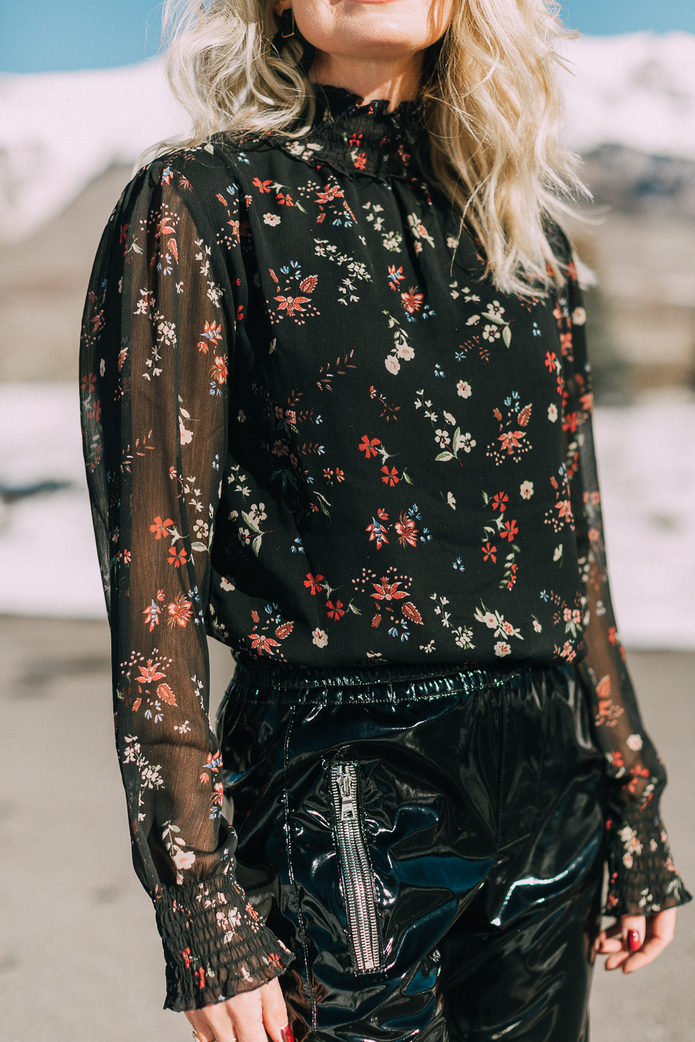 Fashion Blogger Erin Busbee of Busbee Style wearing a black floral blouse by Sanctuary tucked in to vinyl pants by RtA